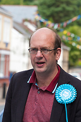 © Licensed to London News Pictures. 27/07/2019. Ystradgynlais, Powys, Wales, UK. Mark Reckless MP joins the campaigning in Wales. Des Parkinson, retired former Welsh police chief superintendent and Brexit Party candidate for the Brecon & Radnorshire constituency, continues his campaign in Mid Wales to win the seat in the forthcoming by-election on 1st August 2019.<br /> The by-election has been recalled because the incumbent Tory MP Chris Davies has been booted from the seat after a recall petition was passed when more than 10,000 voters backed the move. <br /> The Brexit Party was founded by former UKIP economics spokeswoman, Catherine Blaiklock in January 2019, and is led by Nigel Farage. The Brexit party has 29 Members of the European Parliament (MEPs) and four Welsh Assembly Members. The party's first major electoral success was winning the 2019 European Parliament election in the United Kingdom after four months in existence. Photo credit: Graham M. Lawrence/LNP