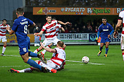 AFC Wimbledon midfielder Anthony Hartigan (8) pulling the ball back into the box during the The FA Cup match between AFC Wimbledon and Doncaster Rovers at the Cherry Red Records Stadium, Kingston, England on 9 November 2019.