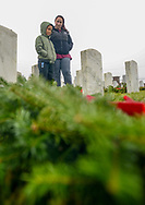 Brittany Wismer of Bensalem and her son Ayden Wismer, 5, visit the grave of Brittany's father during Wreaths Across America Saturday, December 14, 2019 at Washington Crossing National Cemetery in Newtown, Pennsylvania. Thousands of wreaths are laid each year for Wreaths Across America by volunteers who gather and then place the wreaths at graves of veterans. (Photo by William Thomas Cain / CAIN IMAGES)