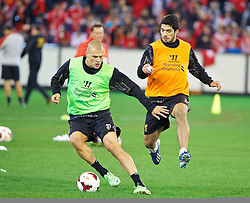MELBOURNE, AUSTRALIA - Tuesday, July 23, 2013: Liverpool's Luis Suarez and Martin Skrtel during a training session at the Melbourne Cricket Ground ahead of their preseason friendly against Melbourne Victory. (Pic by David Rawcliffe/Propaganda)