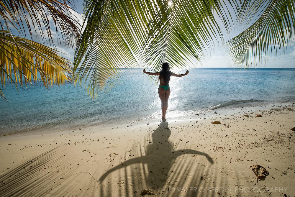 A tourist waits for the sun to set on a beach of Fakarava, one of the Tuamoto archipelago atolls