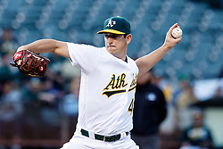 OAKLAND, CA - JUNE 14:  Eric Surkamp #48 of the Oakland Athletics pitches against the Texas Rangers during the first inning at the Oakland Coliseum on June 14, 2016 in Oakland, California. (Photo by Jason O. Watson/Getty Images) *** Local Caption *** Eric Surkamp