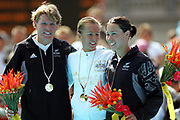 (L-R) Samantha Warriner (NZL, Silver), Emma Snowsill (AUS, Gold) and Andrea Hewitt (NZL, Bronze) after competing in the Women's Triathlon race on Day 3 of the XVIII Commonwealth Games at St.Kilda, Melbourne, Australia on Saturday 18 March, 2006. Photo: Sport the Library / www.photosport.nz