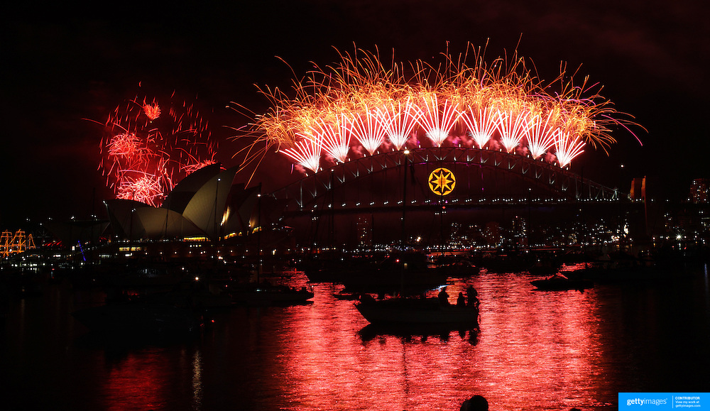 SYDNEY-JANUARY 01: Sydney welcomes New Year with Fireworks..The night sky above The Sydney Harbor Bridge and the Sydney Opera House is lit up by fireworks during the traditional New Years fireworks display on January 1, 2009 in Sydney, Australia...