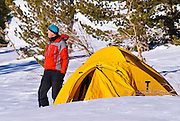Backcountry skier and yellow dome tent, Inyo National Forest, Sierra Nevada Mountains, California