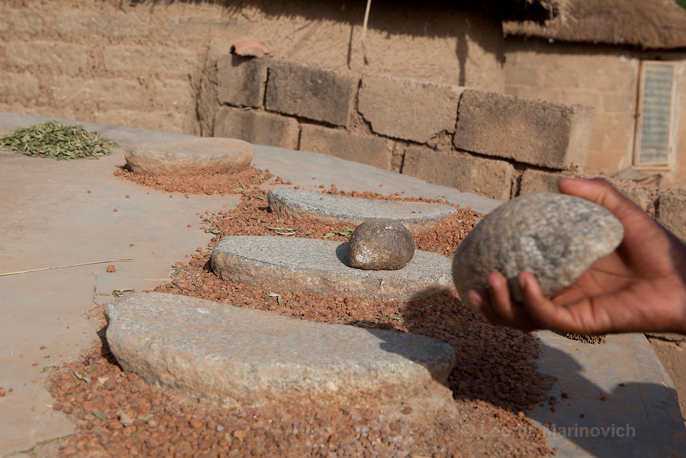 21 June 2010. Meguet, Burkina Faso. Grinding stones on a cement slab for grinding grains down to flour. With so many grinding stones on a slab, it appears to be quite a social event.