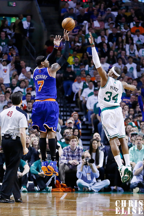 28 April 2013: New York Knicks small forward Carmelo Anthony (7) takes a jumpshot over Boston Celtics small forward Paul Pierce (34) during Boston Celtics overtime 97-90 victory over the New York Knicks during Game Four of the Eastern Conference Quarterfinals of the 2013 NBA Playoffs at the TD Garden, Boston, Massachusetts, USA.