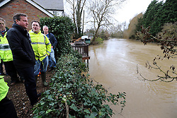 Prime Minister David Cameron looks at the flood level of the River Beult during a tour of the village of Yalding, Kent, United Kingdom , after the floods, Friday, 27th December 2013. Picture by Stephen Lock / i-Images
