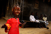LOME, TOGO  - The smile thief is a witch who robs children of their happiness in the night, when she transforms into a mosquito. Only children who sleep under mosquito net are safe from the sickness and sadness she brings. Bacco says this health oriented marionette is one of her most successful.   Photo by Daniel Hayduk