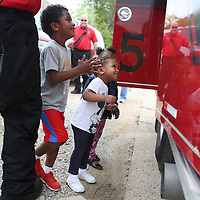 Lauren Wood | Buy at photos.djournal.com<br /> Noa Little and Jalynn Cummings peek to see what is inside one of the compartments on the firetruck as  firefighters from Tupelo Station No. 5 visit the Brown Bear Child Care and Learning Center Wednesday morning.