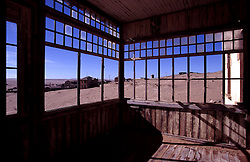 View through windows of disused building in desert ghost town (Credit Image: © Axiom/ZUMApress.com)