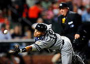 Yankees catcher Ivan Rodriguez (12) tries to catch a popped-up bunt attempt by the Orioles' Juan Castro (2) in the 4th inning. Rodriguez did not make the catcgh but Castro eventually struck out. The Orioles lost 5-3 to the Yankees in Orioles Park at Camden Yards.