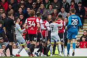 More players join in the scuffle between Ezri Konsa Ngoyo (Brentford) & Tom Lawrence (Derby County) during the EFL Sky Bet Championship match between Brentford and Derby County at Griffin Park, London, England on 6 April 2019.