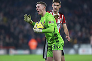 Dean Henderson celebrates saving a penalty from Gabriel Jesus during the Premier League match between Sheffield United and Manchester City at Bramall Lane, Sheffield, England on 21 January 2020.