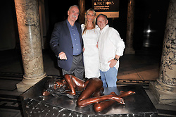 Left to right, JOHN CLEESE, JENNIFER WADE and JONATHAN WYLDER at a private view of a new collection of bronzes and original paintings by artist Jonathan Wylder and his muse Jennifer Wade held at the V&A Museum, London on 27th April 2011.