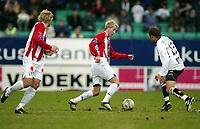 Fotball, 26. april 2003, Tippeligaen, Sogndal-Tromsø 3-1. Morten Gamst Pedersen, Tromsø, mot Alexander Ødegaard, Sogndal