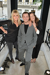 Left to right, JO WOOD, TYRONE WOOD and LEAH WOOD at a private view and launch of the new Heist Gallery at 43 Linden Gardens, London W2 on 12th June 2014.