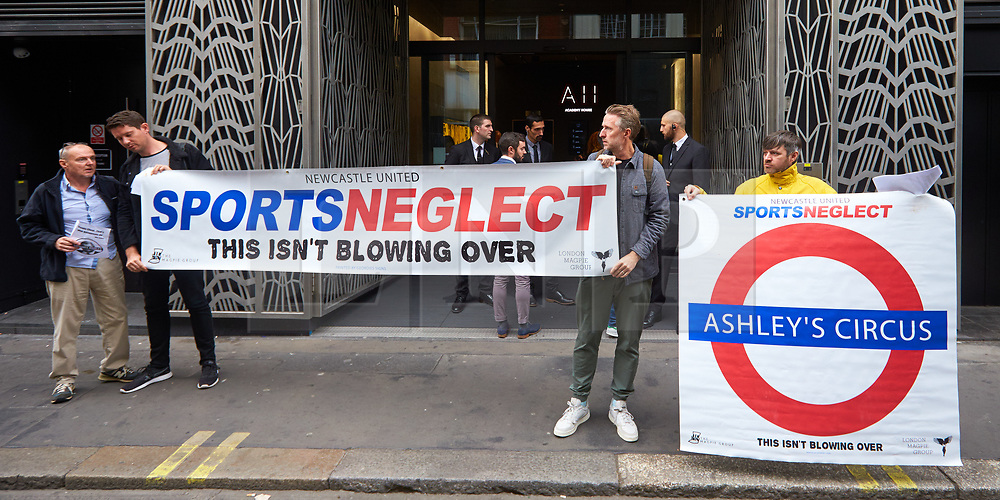 © Licensed to London News Pictures. 11/09/2019. London, UK.  Protesters  pictured outside the Sports Direct International plc held in Academy House in Poland Street.   Photo credit: Cliff Hide/LNP