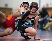 Jake Bell of Fairport, left, competes against Brandon Macdonell of Midlakes in the 106-pound weight class during a match at Fairport High School on Saturday, December 13, 2014.