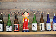 BROOKLYN, NY - April 24, 2015: A bobble-head doll among the sake selection at Ganso Yaki in Downtown Brooklyn.<br /> <br /> CREDIT: Clay Williams for Food Republic.<br /> <br /> © Clay Williams / claywilliamsphoto.com