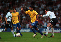 Photo: Tony Oudot.<br /> England v Brazil. International Friendly. 01/06/2007.<br /> Ronaldinho of Brazil goes past Jamie Carragher of England