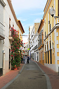 Narrow street in old city centre area, Merida, Extremadura, Spain