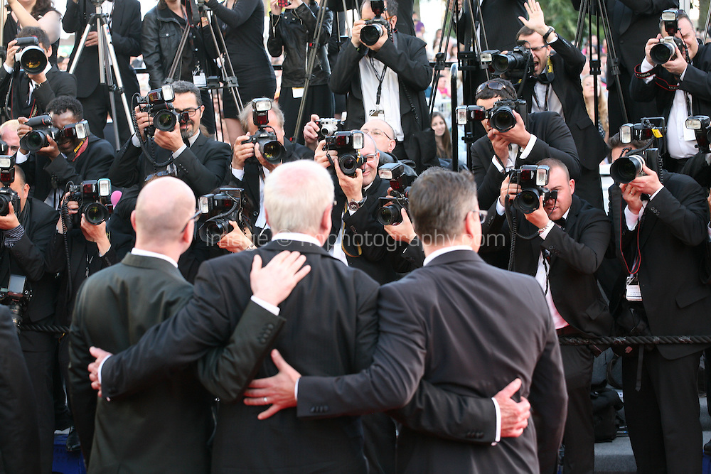 Steven Soderbergh, Jerry Weintraub and Matt Damon face the press photographers .at the 'Behind The Candelabra' gala screening at the Cannes Film Festival  Tuesday 21 May 2013