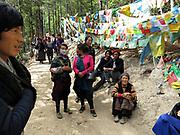 A group of Tibetan pilgrims takes a mid-morning break as they walk from Nanzang Pass to Xidang Springs during their kora (circumambulation) of Kawagarbo. Yunnan, China; September, 2013.