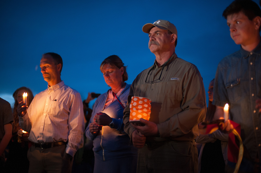 Wife and husband, Kate Walker and Randy Smith (center), host family to German exchange student, Diren Dede, at his vigil on May 2, 2014, at the Fort Missoula soccer field where Dede played.