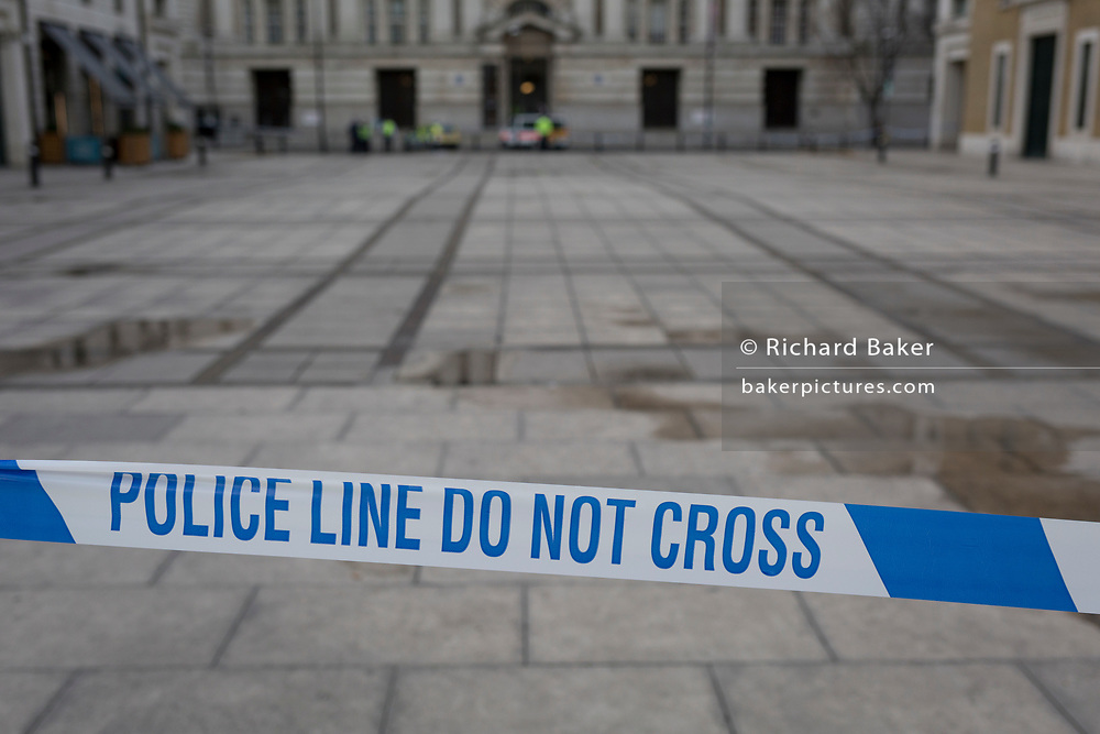 Police tape closes a square on the Southbank, four people were killed (including the attacker) and 20 injured during a terrorist attack on Westminster Bridge and outside the Houses of Parliament, on 22nd March 2017, in central London, England. Parliament was in session and all MPs and staff and visitors were in lock-down while outside, the public and traffic were kept away from the area of Westminster Bridge and parliament Square, the scenes of the attack. It is believed a lone man crashed his car into pedestrians then, armed with a knife tried to enter Parliament, stabbing and killing a police officer at parliament's main gates.