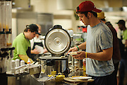 Ohio University student Martin Ernsberger serves himself food from the line at Nelson Dining hall at dinner on Sunday, December 2, 2012.  (© Brien Vincent)