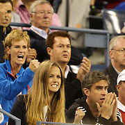 Kim Sears (front) and Judy Murray cheer on Andy Murray, Great Britain, in action against Novak Djokovic, Serbia, in the Men's Singles Final during the US Open Tennis Tournament, Flushing, New York. USA. 10th September 2012. Photo Tim Clayton