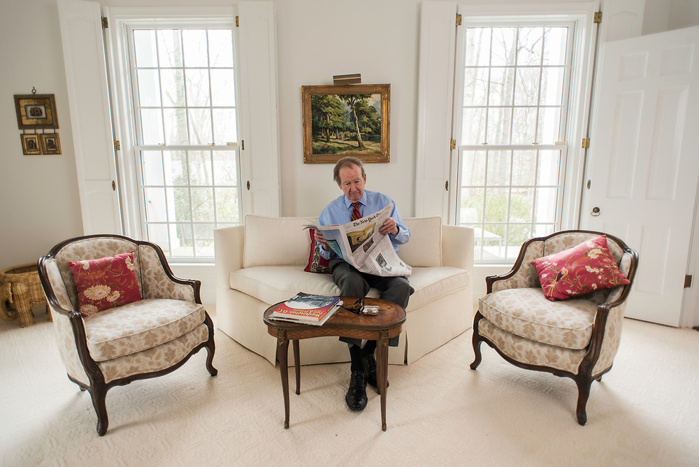 MCLEAN, VA -- 3/21/17 -- Buchanan reads five newspapers front-to-back everyday. Respected conservative commentator Pat Buchanan reflects on his career at his home in McLean. .…by André Chung #_AC23888