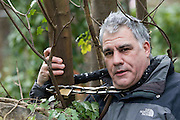 UNITED KINGDOM, London: 02 February 2016 Protester Lewis Schaffer, from the Save Southwark Woods campaign, chains himself to a tree in Camberwell Old Cemetery. Save Southwark Woods are protesting about tree felling in the cemetery, which they claim is on consecrated and protected land. Rick Findler / Story Picture Agency
