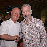 March 6, 2015, Indian Wells, California:<br /> John McEnroe poses for a photograph with Nobu Matsuhisa in his restaurant, Nobu, during the McEnroe Challenge for Charity VIP Draw Ceremony in Stadium 2 at the Indian Wells Tennis Garden in Indian Wells, California Friday, March 6, 2015.<br /> (Photo by Billie Weiss/BNP Paribas Open)