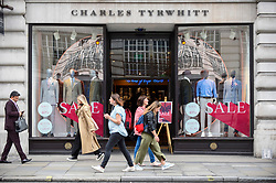 © Licensed to London News Pictures. 19/06/2019. LONDON, UK.  Tourists and Londoners pass by a retail store on Regent Street as the Summer Sales season begins, with many stores offering large discounts to clear inventories.  As retailers continue to face the threat of online shopping, some well known high street store chains have proposed company voluntary arrangements (CVA) to try to reduce high fixed rental property costs.  Photo credit: Stephen Chung/LNP