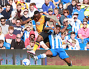 Hull City midfielder Moses Odubajo hurdles a challenges from Brighton midfielder winger Kazenga LuaLua during the Sky Bet Championship match between Brighton and Hove Albion and Hull City at the American Express Community Stadium, Brighton and Hove, England on 12 September 2015. Photo by Bennett Dean.