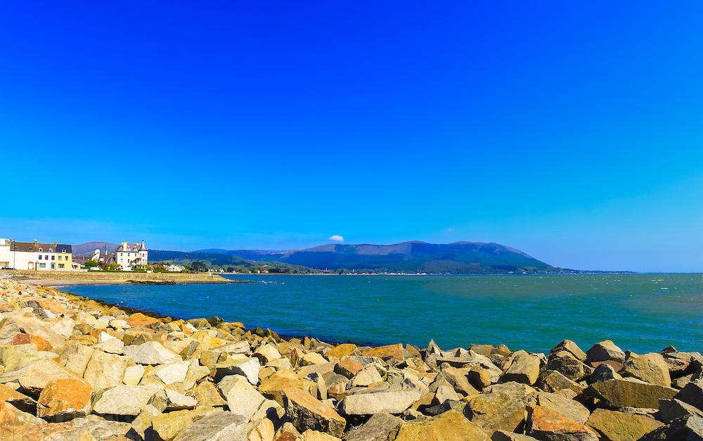 View of the Mourne Mountains from Warrenpoint pier overlooking Carlingford Lough including, from left, Warrenpoint, Ballymoney wood/Carrickbawn wood and Thunder's Hill, Slievemeel, Slievedermot, Rostrevor, Slievebane, Slievemartin, Cloghmore, Slievemeen, Slieveban, Killowen, Killowen Point and Greencastle pier