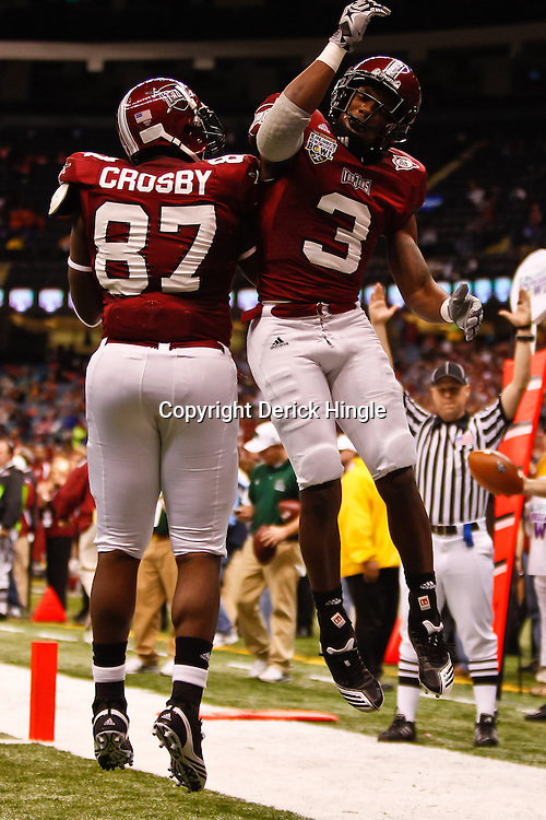 December 18, 2010; New Orleans, LA, USA; Troy Trojans wide receiver Jerrel Jernigan (3) celebrates with tight end Donnie Crosby (87) following a touchdown against the Ohio Bobcats during the first quarter of the 2010 New Orleans Bowl at the Louisiana Superdome.  Mandatory Credit: Derick E. Hingle