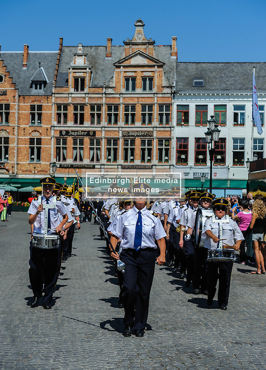 A marching band in the Grote Markt, Bruges, Belgium as part of the celebrations of Belgium's National Day on 22nd July.<br /> <br /> (c) Andrew Wilson | Edinburgh Elite media