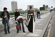 Gormley sculpture dressed by a joker, Antony Gormley - private view,  Hayward Gallery, South Bank, London, 16 May 2007.  -DO NOT ARCHIVE-© Copyright Photograph by Dafydd Jones. 248 Clapham Rd. London SW9 0PZ. Tel 0207 820 0771. www.dafjones.com.