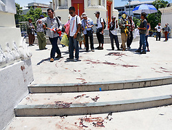 © Licensed to London News Pictures. 15/05/2014. PDRC protestors inspect the blood stains at the site of a grenade and gun shots attack at Democracy monument in Bangkok on May 15, 2014. Grenade blasts and gunfire rocked an anti-government protest site in Thailand's capital, leaving two dead and 24 wounded as fears of wider political violence mounted in Bangkok Thailand. Photo credit : Asanka Brendon Ratnayake/LNP