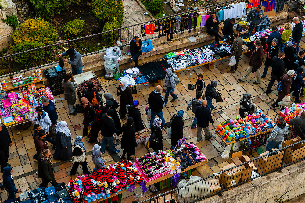 Overview of the street market at tje Damascus Gate in the  Old City,  seen from the 16th century ramparts, Jerusalem, Israel.