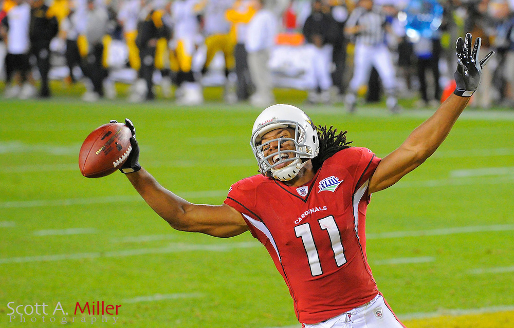 Feb 1, 2009; Tampa, FL, USA; Arizona Cardinals wide receiver Larry Fitzgerald (11) celebrates after catching a pass for a touchdown during the fourth quarter of Super Bowl XLIII against the Pittsburgh Steelers at Raymond James Stadium.  .©2009 Scott A. Miller