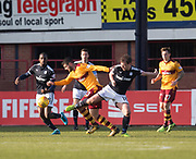 24th February 2018, Dens Park, Dundee, Scotland; Scottish Premier League football, Dundee versus Motherwell; Nadir Ciftci of Motherwell goes past Charles Dunne of Motherwell