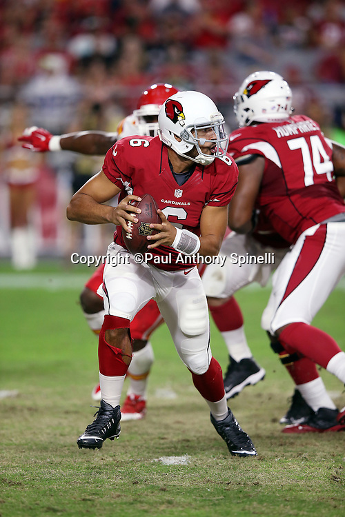 Arizona Cardinals quarterback Logan Thomas (6) scrambles while looking to pass during the 2015 NFL preseason football game against the Kansas City Chiefs on Saturday, Aug. 15, 2015 in Glendale, Ariz. The Chiefs won the game 34-19. (©Paul Anthony Spinelli)
