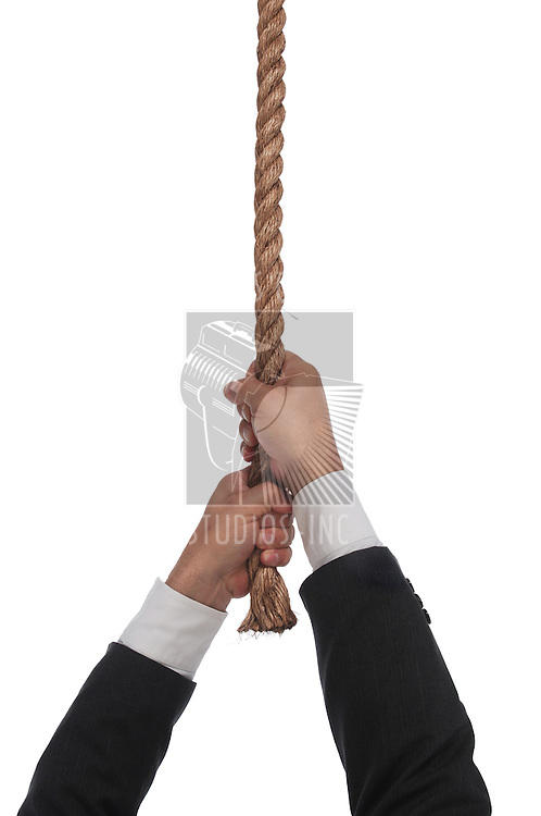 man hanging at the end of his rope on white background