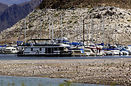 Recreational watercraft moored in Las Vegas Bay Marina on Lake Mead give scale to the decreased water level in Lake Mead near Las Vegas, Nevada.  Tuesday, April 20, 2004.