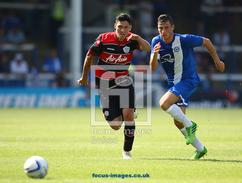 Picture by Rob Fisher/Focus Images Ltd +44 7450 945824<br /> 13/07/2013<br /> Joe Newell of Peterborough United and Alejandro Faurlin of Queens Park Rangers during the pre season friendly match at London Road, Peterborough.