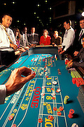 An excited group of people playing Craps at  Caesar's Casino in Atlantic City, NJ.